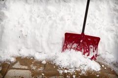 Snow shovel in a snow bank Stock Photos