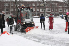 Snow shovel at work Royalty Free Stock Photography