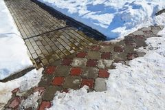 Snow shoveling footpath after snowfall Royalty Free Stock Photo