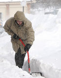 Snow Shoveling In Winter Blizzard Royalty Free Stock Photography
