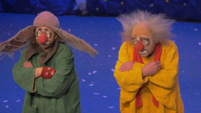 On snow show of Slava Polunin acts are two clowns and start to gesticulate stock footage