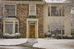 Snow Shower on Stone and Siding House Stock Images