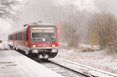 Snow showers covers a running train Stock Photo