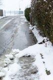 Snow on sidewalk Royalty Free Stock Photography