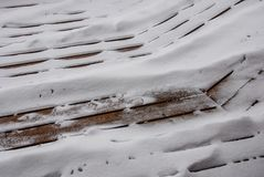Snow sifting through cracks in deck. Snow sift through the lines and cracks of a deck during a midwest winter stock image