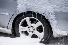 Snow on a silver car Royalty Free Stock Photo