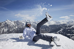 Snow, ski, sun and fun. Happy female skier playing in snow outdoor Royalty Free Stock Photos