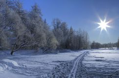 Snow ski trail and Sun Royalty Free Stock Images