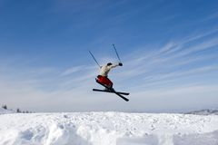 Snow Skier Jumping Against Blue Sky. In winter mountains Tien Shan Stock Photos