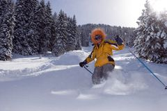 Snow Skier in winter forest. In mountains Royalty Free Stock Images