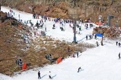 Snow skiers in Whakapapa skifield on Mount Ruapehu Stock Photo