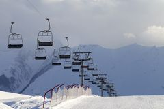 Snow skiing piste and ropeway Stock Photography