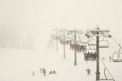 Snow skiing during snow fall Royalty Free Stock Images