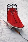 Snow sled. Red snow sled ready to go Stock Photos