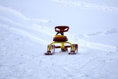 Snow sled steering wheel and snowmobile royalty free stock photos