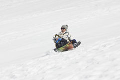 Snow sledding Crash Royalty Free Stock Photo