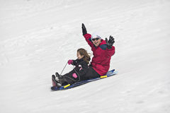 Snow sledding fun Royalty Free Stock Image