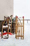 Snow sleds waiting for children near house Royalty Free Stock Images