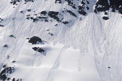 Snow slide in mountains Stock Photo