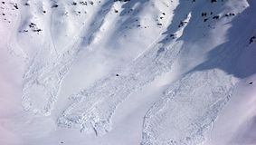 Mini avalanches on a mountain in alaska in the spring. Snow slides as seen at the summit of atigun pass Stock Photography