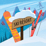 Snow slope with skis, snowboard and inscription Royalty Free Stock Images