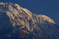 The snow slopes of Annapurna South. Trekking to Annapurna Base C. Amp, Nepal stock photos