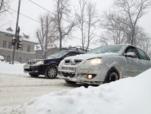 Snow slowing traffic. In Bucharest, Romania on February 13, 2012 Stock Photography