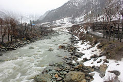 Snow, Slush And Stones Line The Banks Of Sind River Stock Image