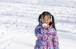 The snow with a snowball smile of Chinese woman. Standing in the snow with a snowball eyes smiling Chinese woman Stock Photography