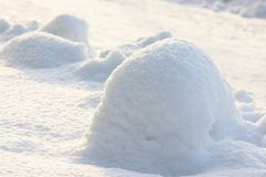 Snow snowbank on a Sunny day. Fluffy snow shimmers in the sun, abstract natural figures. Snow snowbank on Sunny day. Fluffy snow shimmers in the sun, abstract royalty free stock images