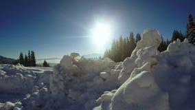 Snow snowdrifts in mountain village stock video footage