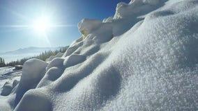 Snow snowdrifts in mountain village stock footage