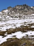 Snow in the Snowy mountains. The natural shaped rocks in the Snowy mountains above the village Thredbo near Jindabyne in New South Wales in Australia Stock Photos