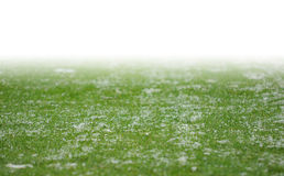 Snow on soccer pitch Stock Photos