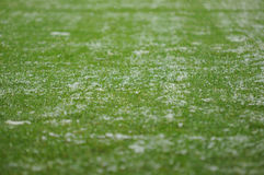 Snow on soccer pitch Stock Photo