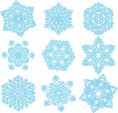 Snow. Some different snowflakes on a white background stock illustration