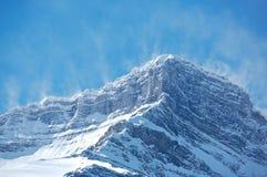 Snow spindrift on mountain peak 01 Stock Image