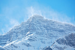 Snow spindrift on mountain peak 01 Stock Image