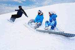 Snow splashes from board near two girls Stock Images