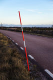 Snow stake by a roadside Royalty Free Stock Photo