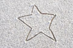 Snow Star. A star marked out on snowy ground stock images