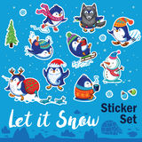 Snow sticker set with cartoon penguins, snowman and snowflakes Royalty Free Stock Photo