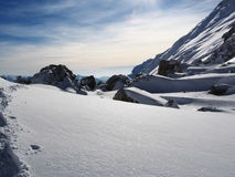 Snow and stone Stock Photography