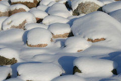 Snow on stones. Inh winter Royalty Free Stock Image