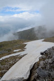 Snow, stones and clouds on Czerwone Wierchy in Tatra mountains Royalty Free Stock Photography