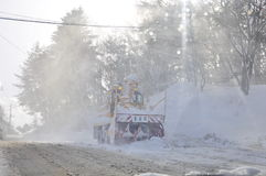After snow storm. Heavy snow on the road of Kusatsu resort area even though the sun is shining brightly. The picture shows a snowplow vehicle clearing the thick Royalty Free Stock Photos