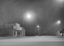 Snow storm. A black and white shot of a small town under a heavy snow storm Stock Images