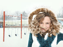Snow Storm Child at School. Adorable 7 year old student outside school in snow storm smiling royalty free stock photography