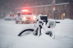 Snow storm in the city. Police car run on emergency call during snow storm in New York City Stock Photos