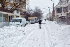 Snow storm hits city. street after blizzard Stock Images